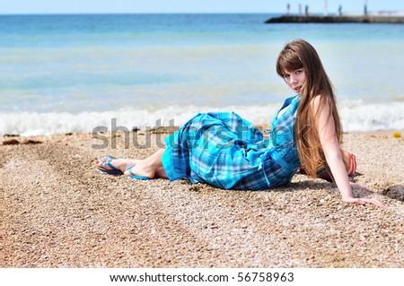 summer longhaired  girl sitting on the beach - stock photo