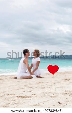 Summer Love on tropical beach, focus on heart - stock photo