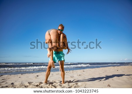 Summer lovers on beach and blue sky.