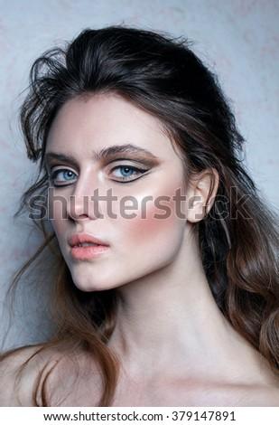 Summer make up. Beauty fashion portrait of a model. Blue eyes. Grey background. Studio shot. Close up. Art style. - stock photo