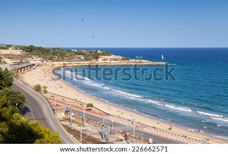 Summer Mediterranean Sea landscape. Central city Beach of Tarragona, Catalonia, Spain