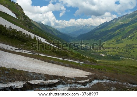 summer meets winter high in Caucasia mountains - stock photo