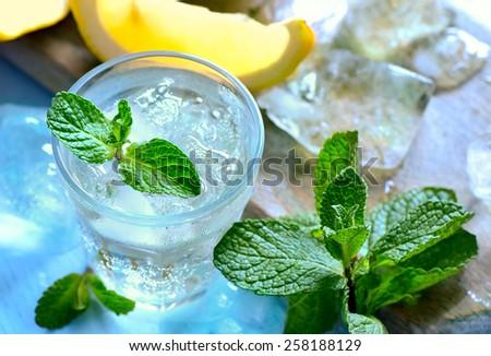 Summer mint lemon cooler, soda with ice or lemon mojito - stock photo