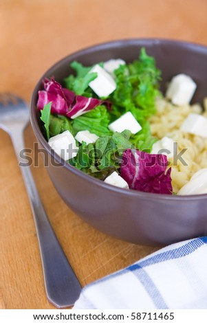 summer mix various of salad with pasta and feta cheese - stock photo