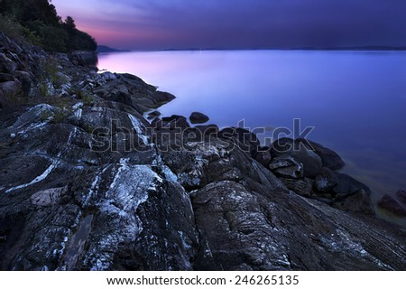 Summer morning by the baltic sea in Sweden, the sun is just about to rise - stock photo