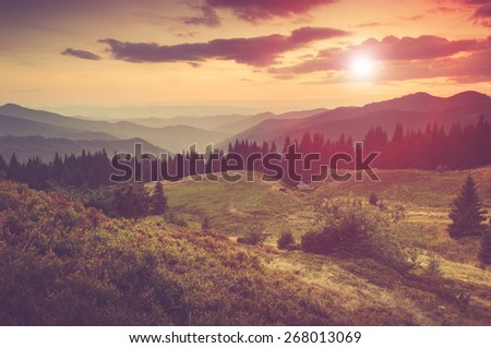 Summer mountain landscape at sunset. Tourist tents near forest. Filtered image:cross processed vintage effect. - stock photo