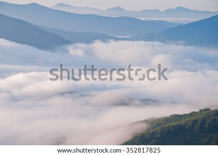 Summer mountain landscape with the sea fog - stock photo