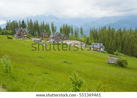Summer mountain landscape with traditional huts in Tatra mountain.