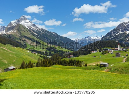 Summer mountain view to Biberkopf mount (Warth, Vorarlberg, Austria). - stock photo