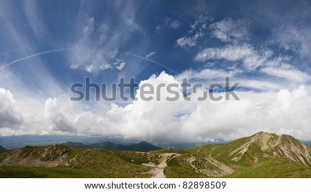summer mountains scenery with cloudy sky - stock photo