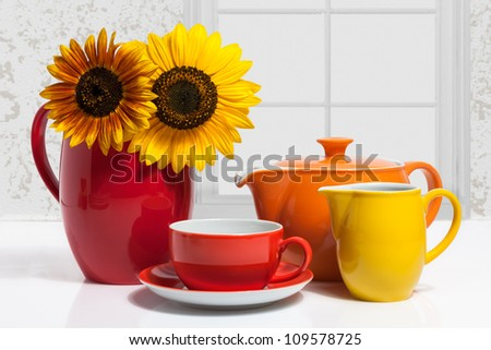 Summer Multicolored Dishware with Sunflower - stock photo