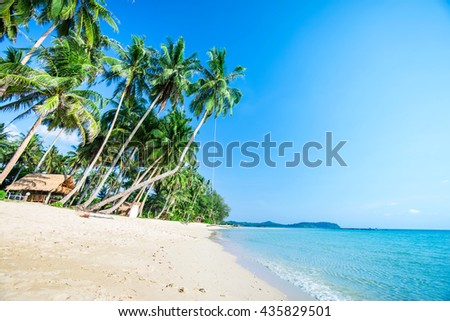 Summer nature scene. Tropical beach with sea, blue sky and palm trees, Kood island is located in the South East part of Thailand. Beautiful sea and white sand beach.