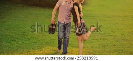 Summer of our love. Young happy couple together in park.  - stock photo