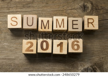 Summer 2016 on a wooden background - stock photo
