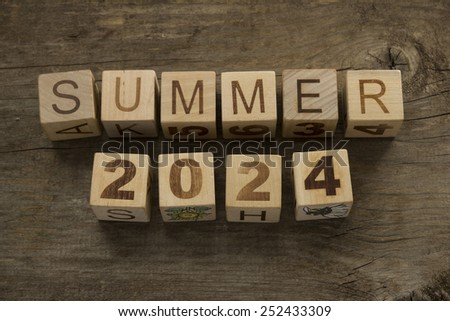 Summer 2024 on a wooden background - stock photo