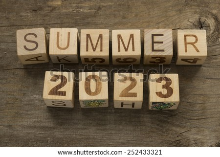 Summer 2023 on a wooden background