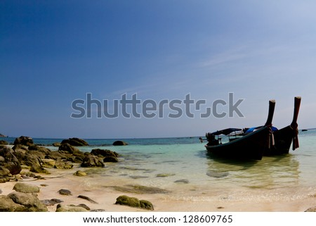 Summer on an isolated beach in Thailand. - stock photo