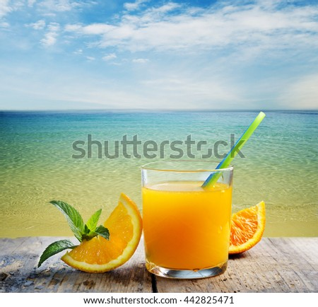 Summer orange cocktail on the beach - stock photo