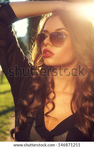 summer outdoor fashion portrait of young beautiful girl - stock photo