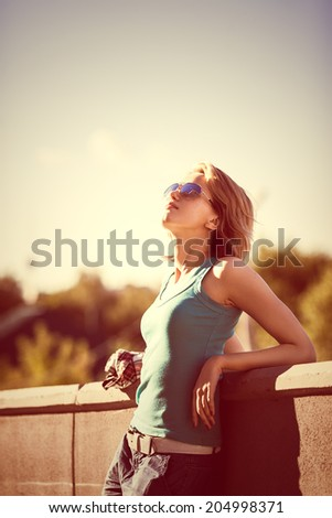 summer outdoor fashion portrait of young beautiful girl with sunglasses - stock photo