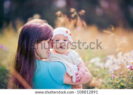 Summer outdoor Portrait of happiness mother with baby girl - stock photo