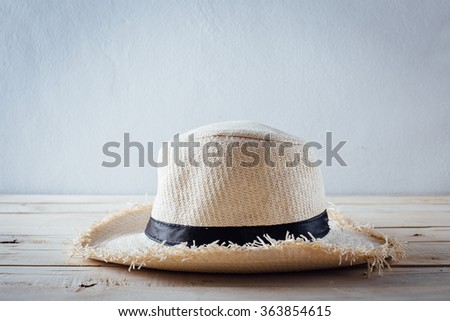 Summer panama straw hat on wooden table - stock photo