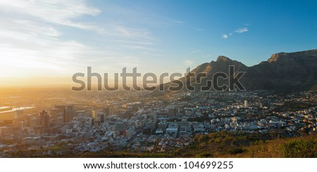 Summer panorama of dawn in the city on the background of the mountains (Cape Town, South Africa - Table Mountain) - stock photo
