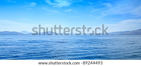 Summer panoramic view of the  sea and mountain range - stock photo
