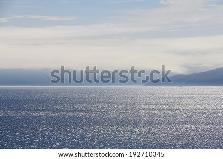Summer panoramic view of the sea and mountain range in northern Norway - stock photo
