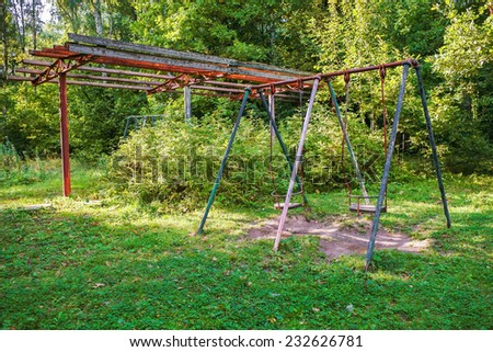 Summer park with old swing - stock photo