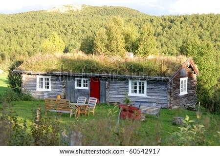 Summer pasture cottage - stock photo