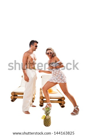 Summer photo of a couple wearing beachwear isolated on white with clipping path