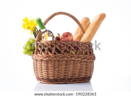 Summer picnic basket full of food - stock photo