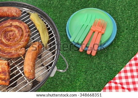 Summer Picnic Or BBQ Party Or Cookout Scene On The Green Lawn, Top View - stock photo
