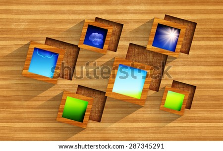 Summer pictures with blue sky, sun, clouds and green ground in wooden frames on wood background with square cavities - stock photo