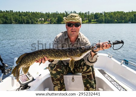 Summer pike fishing in Sweden - stock photo