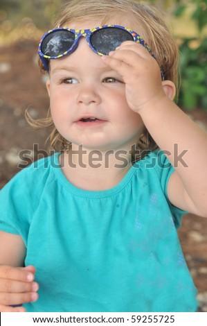 summer portrait: child with sunglasses - stock photo