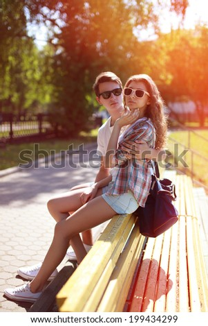 Summer portrait modern urban cool hipster couple in the city, street fashion - stock photo