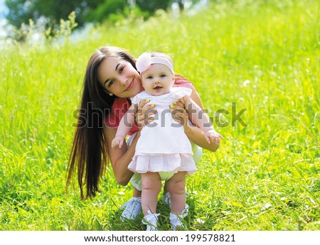 Summer portrait mother with baby in sunny day - stock photo