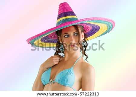 summer portrait of a cute girl wearing a bikini colored scarf and a big colorful hat like a sombrero