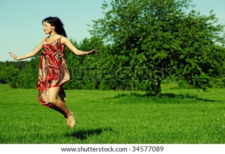 summer portrait of a flying young woman - stock photo