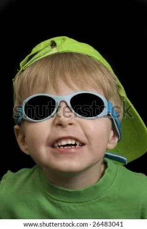 summer portrait of a three year old boy - stock photo