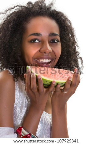 Summer portrait of an African Ethiopian girl with a slice of melon - stock photo