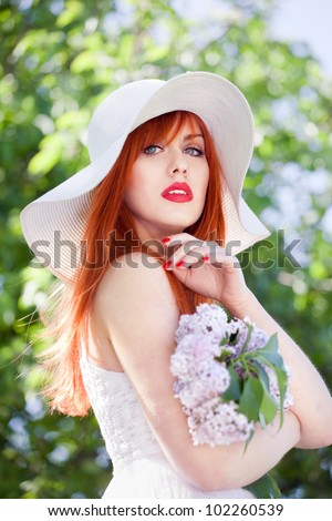 Summer portrait of an attractive woman - stock photo