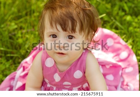 Summer portrait of beautiful baby girl