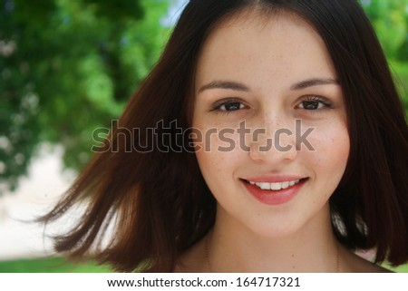 summer portrait of beautiful smiling young brunette woman