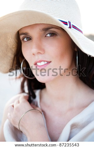 Summer portrait of beautiful woman wearing hat. Vacation at warm country