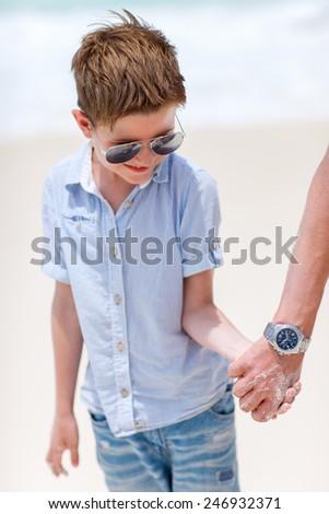 Summer portrait of cute happy little boy on vacation - stock photo