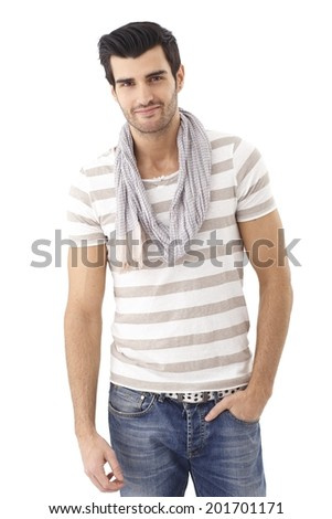 Summer portrait of handsome man in casual clothing, smiling with hand in pocket. - stock photo