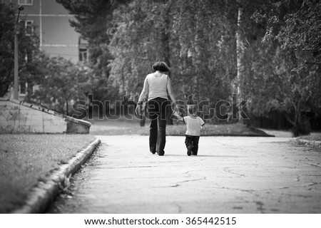 summer portrait of happy grandmother with grandson outdoors - stock photo